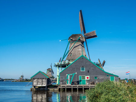 schans: The historic classic windmill named De Kat (The Cat) in Zaan Schans, Netherlands