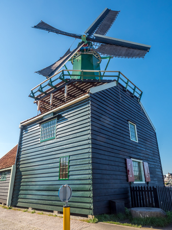 zaan: ZAAN SCHANS - OCTOBER 2: The Historic classic windmill in Zaan Schans named De Huisman (The Houseman), Netherlands, on October 2, 2015.