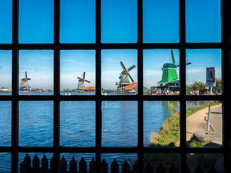 zaan: ZAAN SCHANS - OCTOBER 2: View of four historic classic windmills in rural small town named Zaan Schans, Netherlands, under clear blue sky, on October 2, 2015.