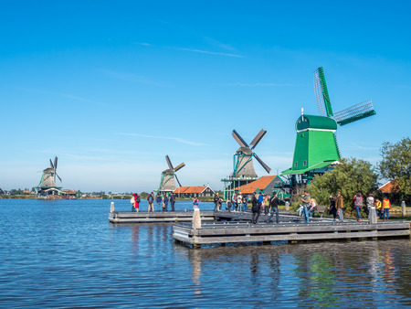 zaan: ZAAN SCHANS - OCTOBER 2: View of four historic classic windmills in rural small town named Zaan Schans, Netherlands, under clear blue sky, on October 2, 2015.