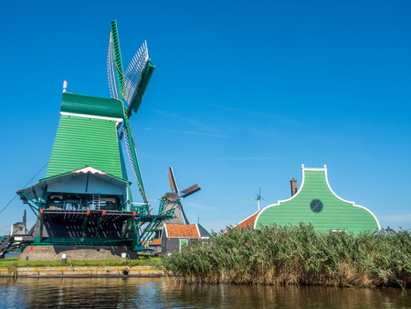 zaan: The historic classic windmill named De Gekroonde Poelenburg (the crowned poelenburg) in Zaan Schans, Netherlands