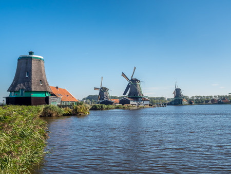 schans: Historic classic windmills in Zaan Schans under blue sky, Netherlands
