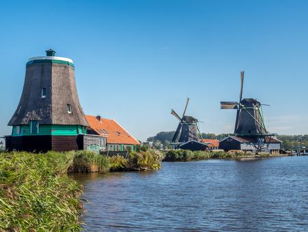 zaan: Historic classic windmills in Zaan Schans under blue sky, Netherlands
