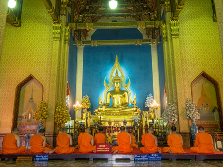 chant: BANGKOK - APRIL 16: Monk come together in hall of main church of Marble temple for evening chant front of The main Buddha statue in Bangkok, Thailand, on April 16, 2016.