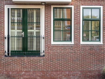 volendam: VOLENDAM - OCTOBER 4: City scene, residential buildings in Volendam, small cute town of Netherlands, was taken on October 4, 2015.