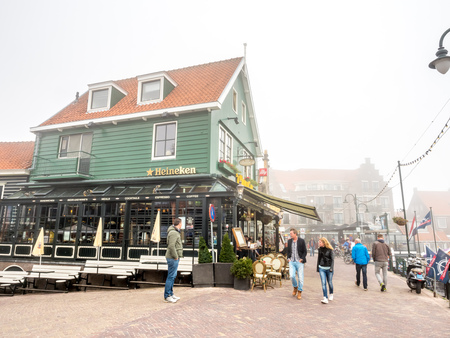 volendam: VOLENDAM - OCTOBER 4: Blurring foggy morning atmosphere in Volendam, small fisherman town of Netherlands, calm and peaceful city, was taken on October 4, 2015. Editorial