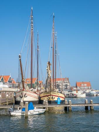 volendam: VOLENDAM - OCTOBER 4: City scene, yacht pier and fisherman village in Volendam, small cute town of Netherlands, was taken on October 4, 2015. Editorial