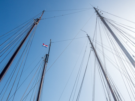 spar: Xebec or spar of yacht with clear blue sky, for background