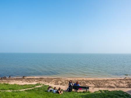 volendam: Coast line and beach with sea view in Volendam, Netherlands, under blue sky