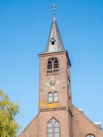 volendam: Saint Vincentius catholic church building is landmark of Volendam, small fisherman town, Netherlands