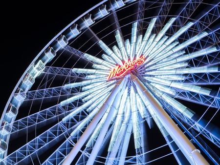 dizziness: BANGKOK - MAY 14: Dizziness moving Large Ferris wheel in Asiatique, open outdoor community shopping mall in Bangkok, Thaialnd, under dark night sky, on May 14, 2016.