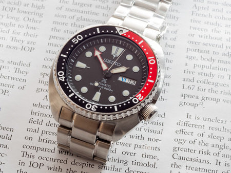 bezel: BANGKOK - MAY 31: Seiko Prospex diver black dial, red and black bezel watch with stainless steel, turtle model