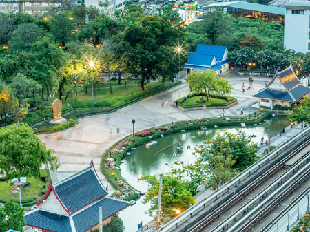 benjakitti: Top view of Benjakitti park with skytrain track in Bangkok with flaring night light bulb