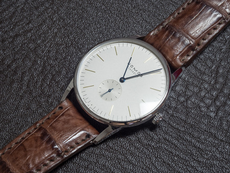 outstanding: BANGKOK - FEBRUARY 5: Nomos watch is Germany watch brand, outstanding with simple clear and clean design, luxury watch with winding machine, white dial and brown alligator strap