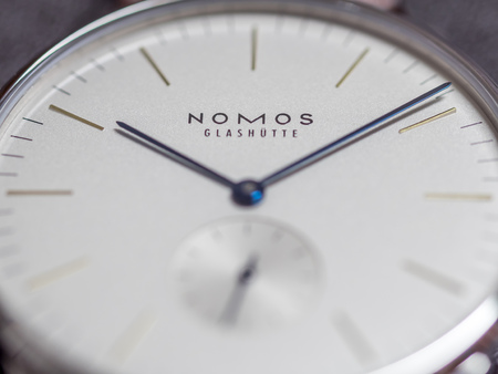calibre: BANGKOK - FEBRUARY 5: Front dial of Nomos watch, Germany watch brand, outstanding with simple clear and clean design, selective focus on its brand logo