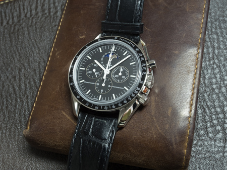 calibre: BANGKOK - JUNE 11: Omega Speedmaster Professional 1866 with moon phase and black alligator strap with brown leather wallet was taken on June 11, 2016, in Bangkok, Thailand. Editorial
