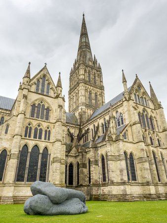 spire: Salisbury cathedral, known as the Cathedral Church of the Blessed Virgin Mary, is an Anglican cathedral, under cloudy rain sky. It has the tallest church spire in UK. Stock Photo