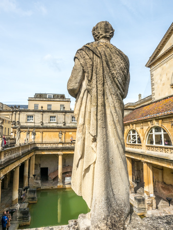 world heritage site: BATH - MAY 19 : Roman Bath, the UNESCO World Heritage site, with green water reflection under cloudy sky Editorial