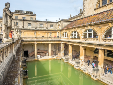 BATH - MAY 19 : Roman Bath, the UNESCO World Heritage site, with green water reflection under cloudy sky Editorial