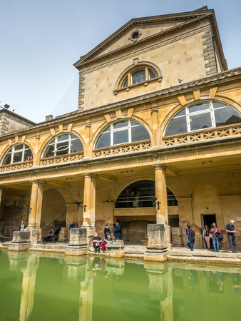 the world heritage: BATH - MAY 19 : Roman Bath, the UNESCO World Heritage site, with green water reflection under cloudy sky Editorial