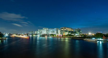Siriraj hospital, the first and largest medical school in Thailand, buildings located along Chaophraya river, under twilight cloudy evening sky