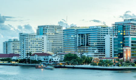 medical school: Siriraj hospital, the first and largest medical school in Thailand, buildings located along Chaophraya river, under twilight cloudy evening sky