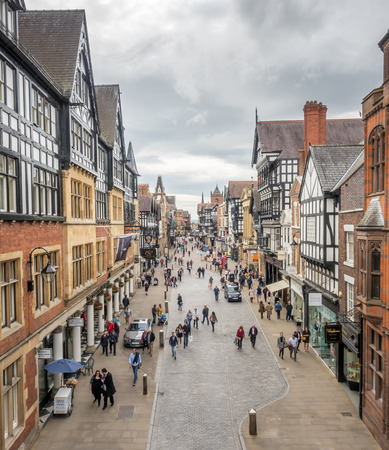 chester: CHESTER - MAY 20 : Eastgate street and tourist in Chester city, England, under cloudy sky, on May 20, 2016. Editorial