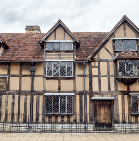 dramatist: STRATFORD - MAY 20: Shakespeare birthplace house in Stratford-upon-Avon in England, the most famous English poet home town, under cloudy sky on May 20, 2016. Editorial