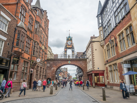 chester: CHESTER - MAY 20 : Eastgate clock tower on bridge in Chester city, England, under cloudy sky, on May 20, 2016.