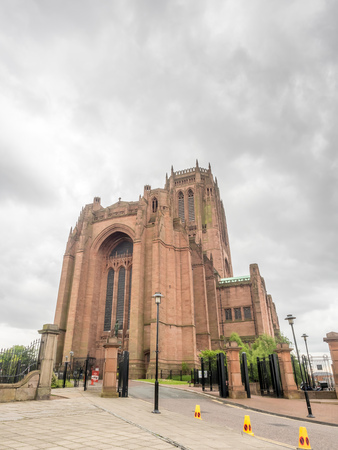 Exterior architecture of Liverpool cathedral, the fifth largest cathedral in the world, under cloudy sky in England