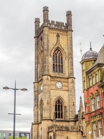 Saint Luke church clock tower in Liverpool city, England, was damage by bombing during war, under cloudy sky