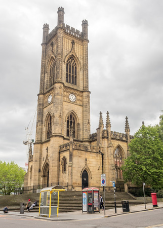 LIVERPOOL - MAY 20: Saint Luke church clock tower in Liverpool city, England, was damage by bombing during war, under cloudy sky, was taken on May 20, 2016.