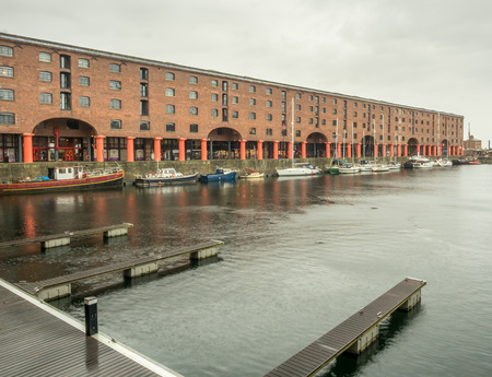 historic place: LIVERPOOL - MAY 20 : The Albert Dock, the UNESCO World Heritage place, is important historic place in Liverpool city, England, under cloudy white sky, was taken on May 20, 2016. Editorial