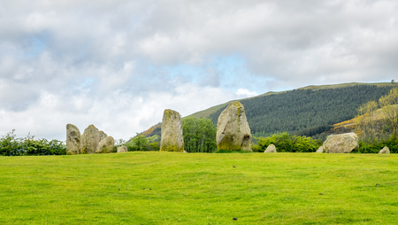 lith: Castlerigg stone circle in Keswick, Cumbria, England, was constructed from prehistoric era, during the Late Neolithic and Early Bronze Ages, under cloudy sky.
