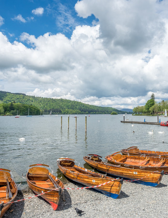 paddles: Kayak boats on lake coast side of lake in Windermere, England