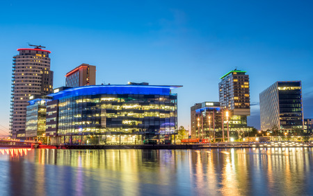 bbc: MANCHESTER - MAY 22: The BBC Media city modern buildings in Manchester city, England, along Salford quays under beautiful twilight evening sky, was taken on May 22, 2016. Editorial