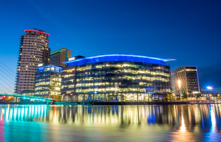 MANCHESTER - MAY 22: The BBC Media city modern buildings in Manchester city, England, along Salford quays under beautiful twilight evening sky, was taken on May 22, 2016. Editorial