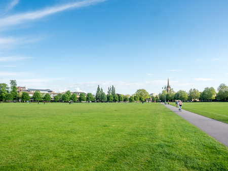 CAMBRIDGE - MAY 23 : Green grass relax outdoor park with cloudy blue sky in Cambridge, England, was taken on May 23, 2016. Editorial