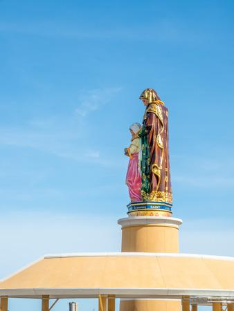 shool: Side view of Saint Anna sculpture under blue sky