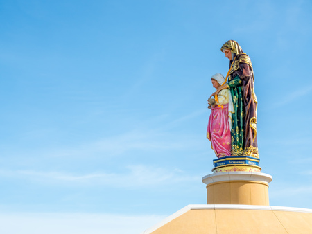 shool: Side view of Saint Anna sculpture under blue sky