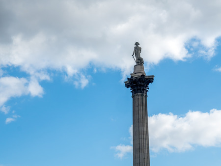 conquer: Tip of the Nelson column at Trafalgar square in London, England, under cloudy sky