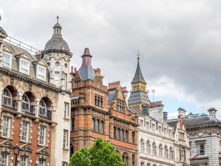 Buildings at the corner of Derby gate along Parliament street in London, England, under cloudy sky Editorial