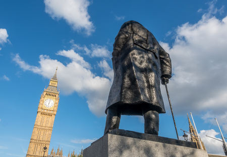 winston: LONDON - MAY 24: Back of Winston Churchill statue with Big Ben on Parliament square garden in London, England, was taken on May 24, 2016.