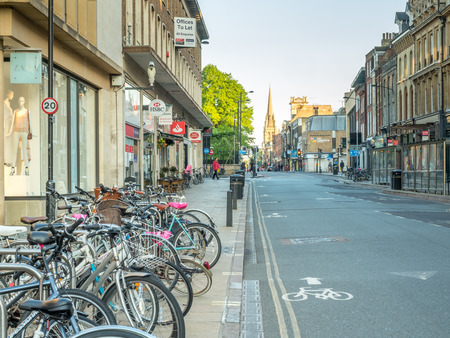 andrew: CAMBRIDGE - MAY 23: Traffic along Saint Andrew street, bicycles, cars and pedestrian in Cambridge, England, on May 23, 2016.