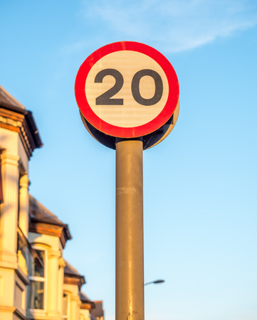 sky is the limit: Speed limit sign, twenty mile per hour, on outdoor pole under blue sky Stock Photo
