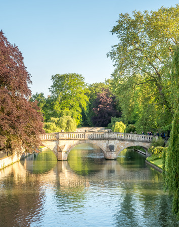 Stone bridge cross Cam river with colorful tree in Cambridge, England Stock Photo