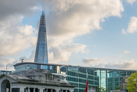 LONDON - MAY 24: The Shard, the tallest skyscaper building in UK, with river Thames scene view under cloudy sky in London, England, was taken on May 24, 2016.