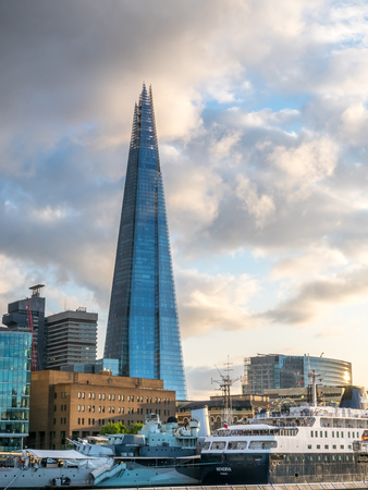 shard: LONDON - MAY 24: The Shard, the tallest skyscaper building in UK, with river Thames scene view under cloudy sky in London, England, was taken on May 24, 2016.
