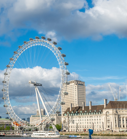 south london: LONDON - MAY 24: London Eye, the giant ferris wheel at the South bank of River Thames in London, England, under cloudy blue sky on May 24, 2016. Editorial