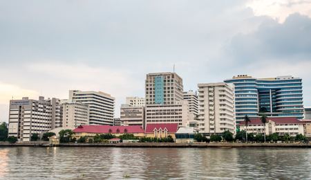 Siriraj Hospital, the first hospital and medical school in Thailand, located along Chaophraya river in Bangkok, under cloudy evening sky